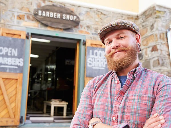 A hipster male business owner